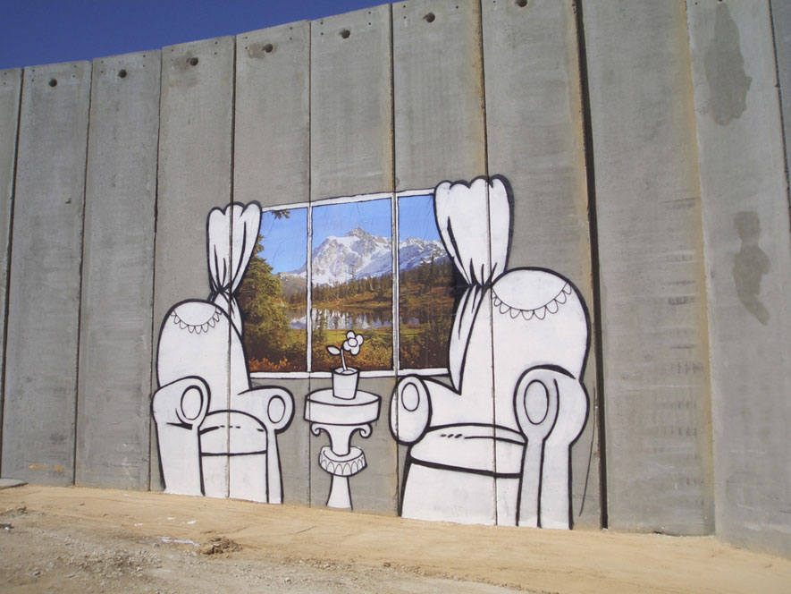 Un graffitti de Bansky en el muro de Palestina